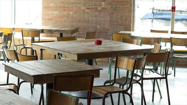 reclaimed pallet and single metal leg tables