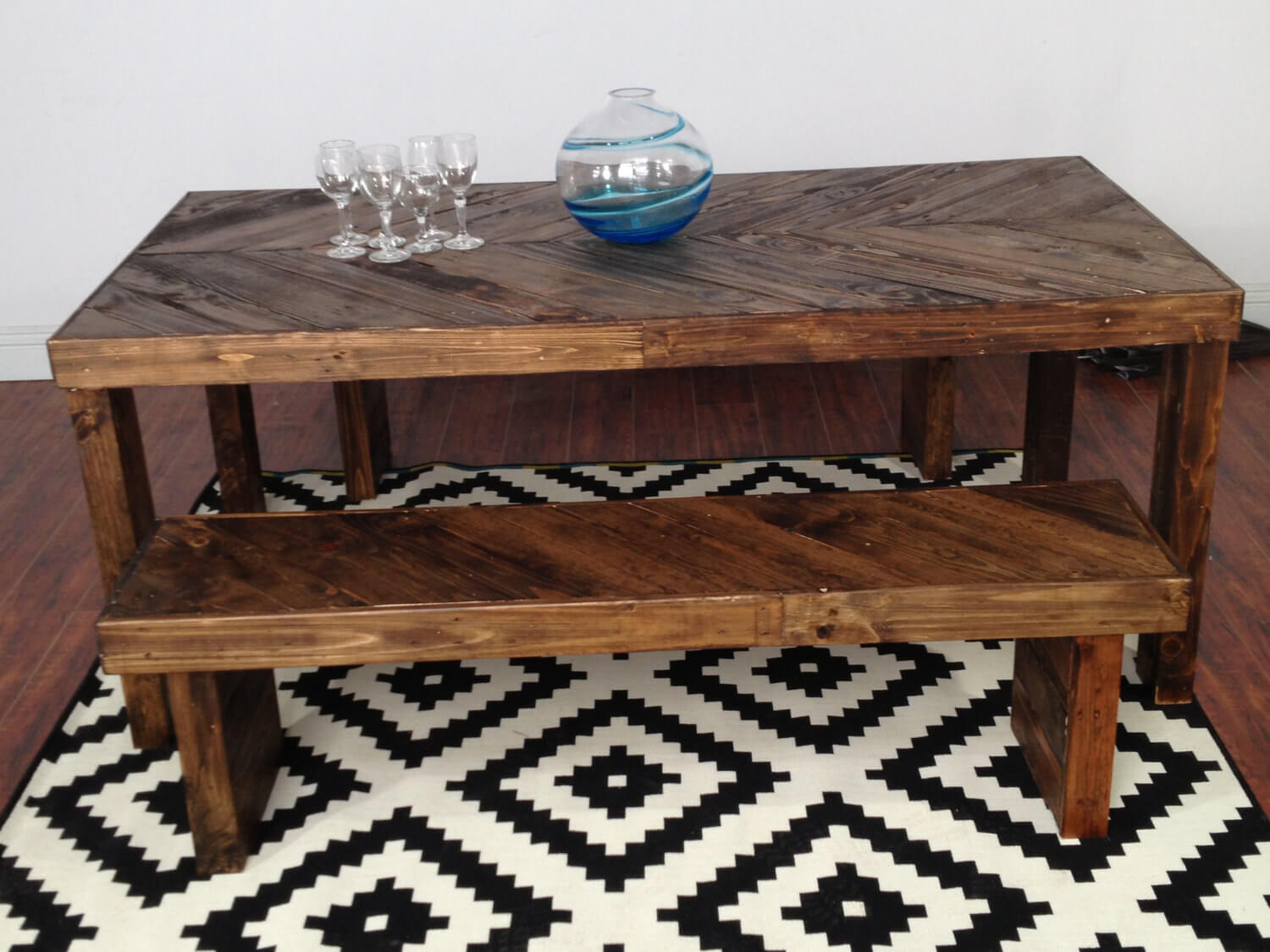 Recycled pallet chevron pattern table with bench