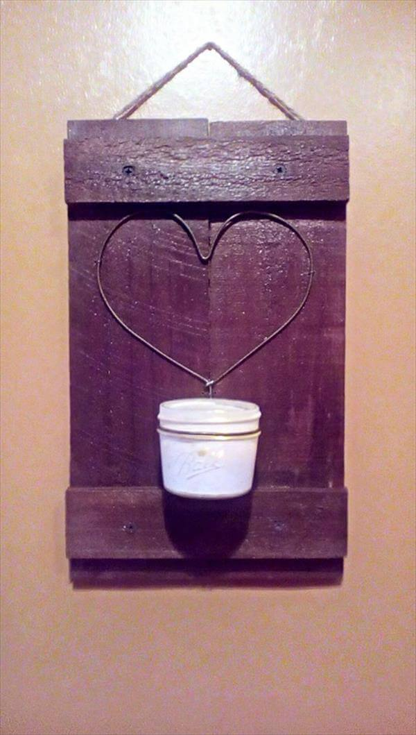 handcrafted pallet love wall art with candle light