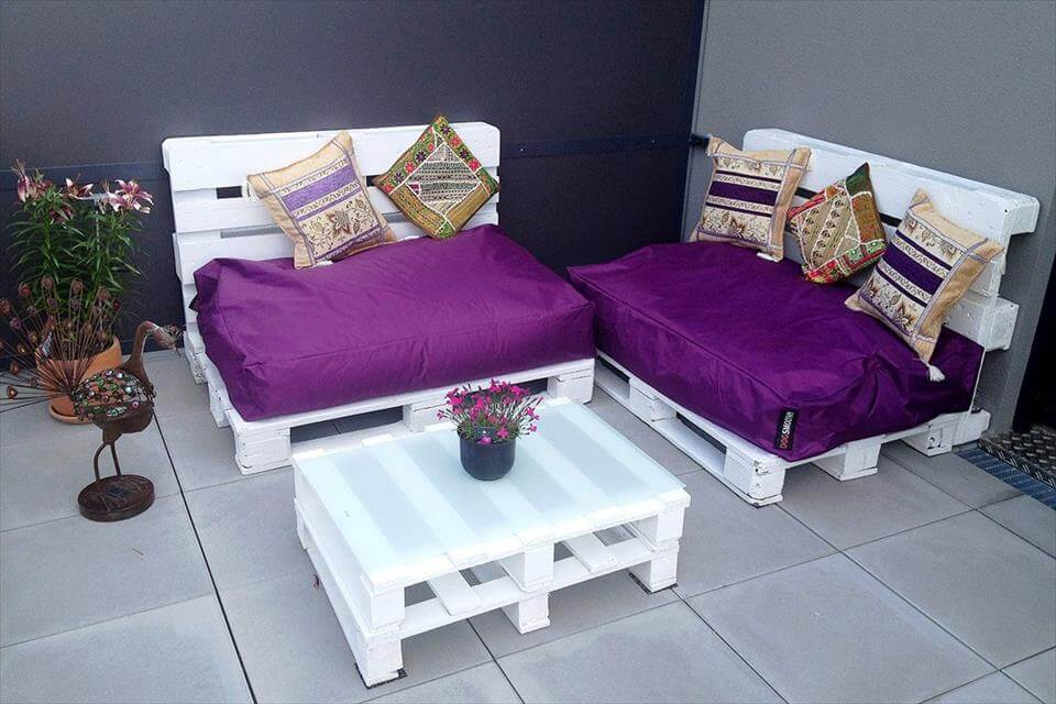 chic white cushioned pallet seats and coffee table