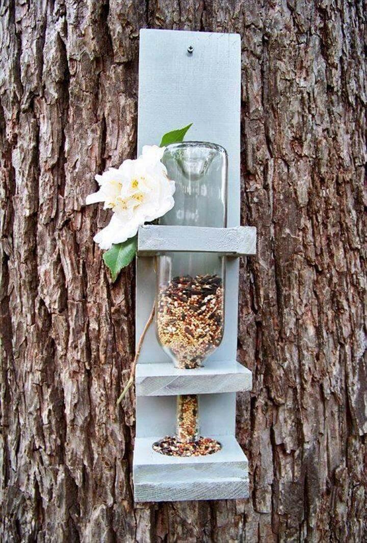 pallet and old glass bottle bird feeder
