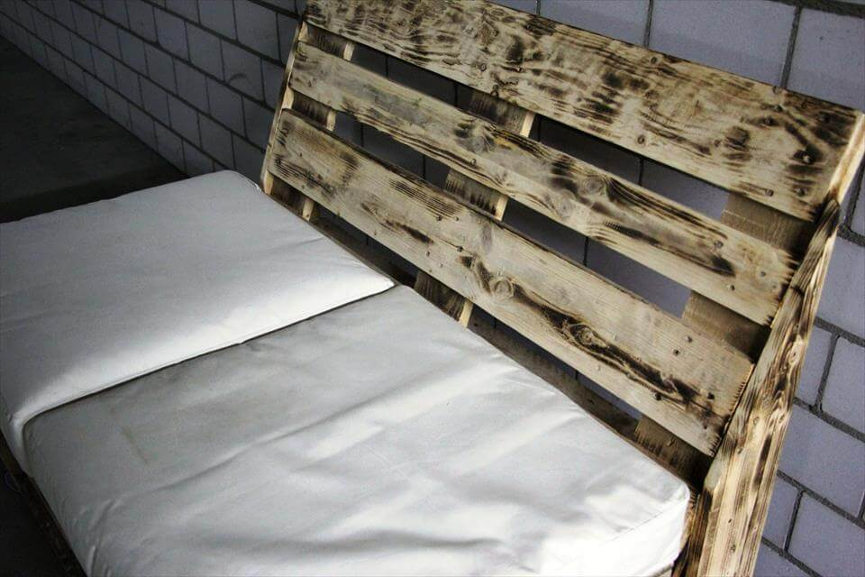 rustic wooden pallet cushioned bench