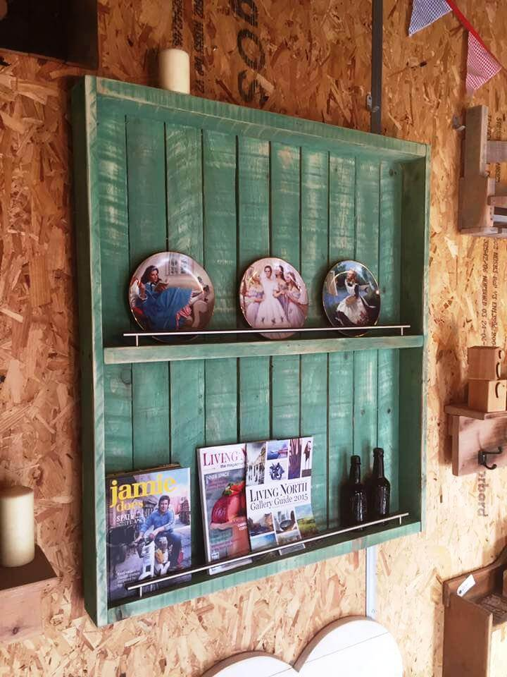 distressed green pallet wall unit